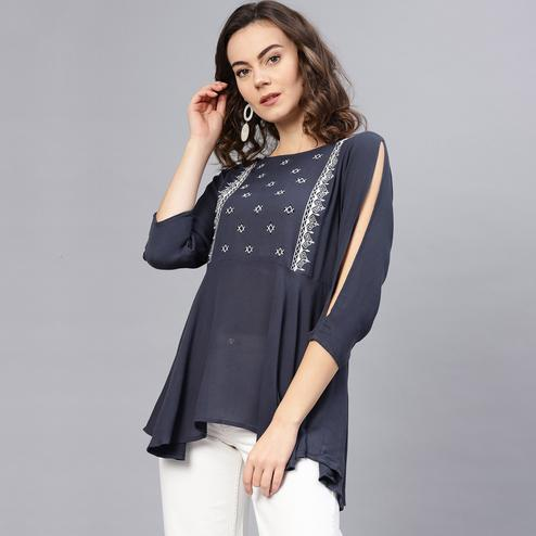 Delightful Blue Colored Casual Wear Embroidered Rayon-Crepe Top