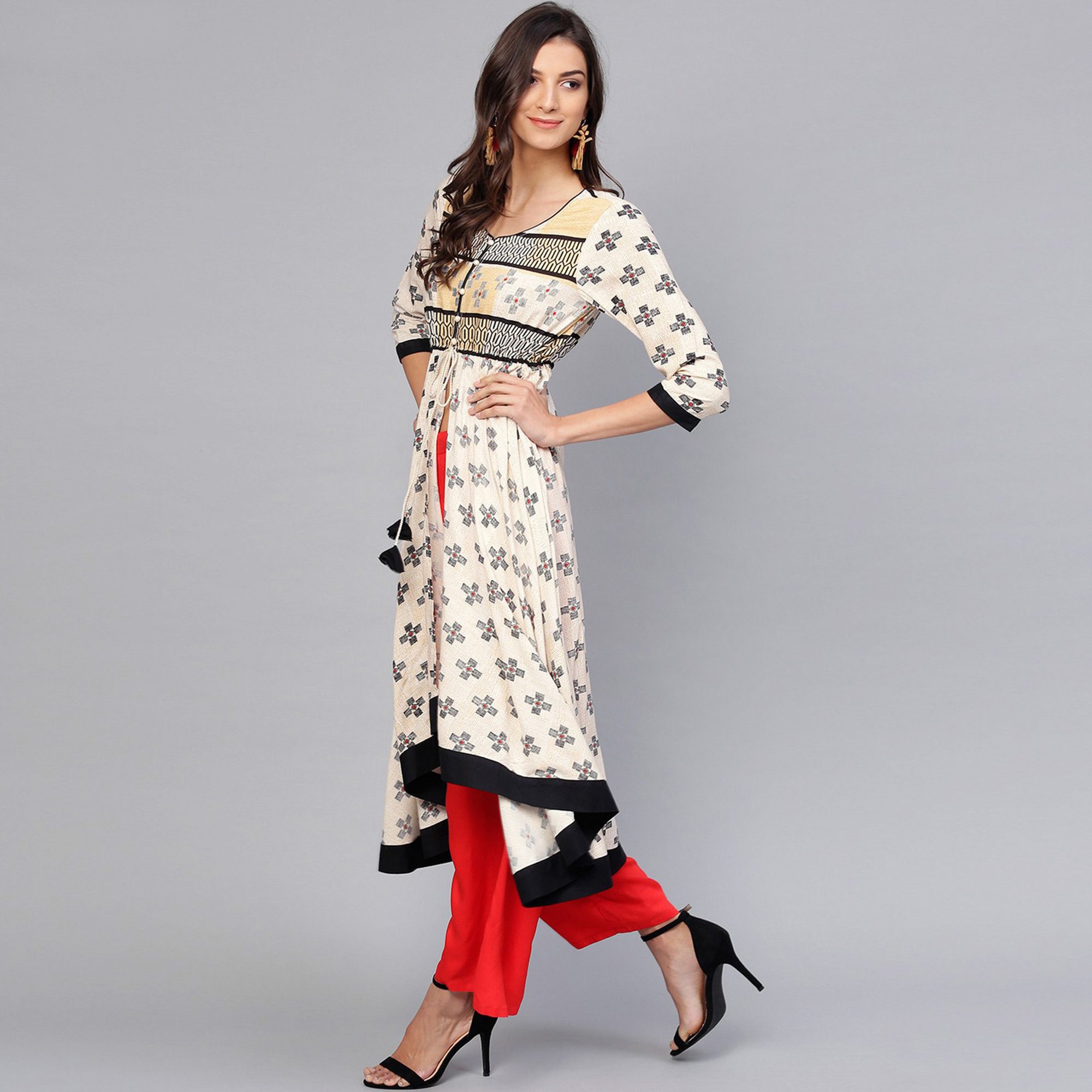 Mesmeric Off White Colored Party Wear Printed Rayon Kurti