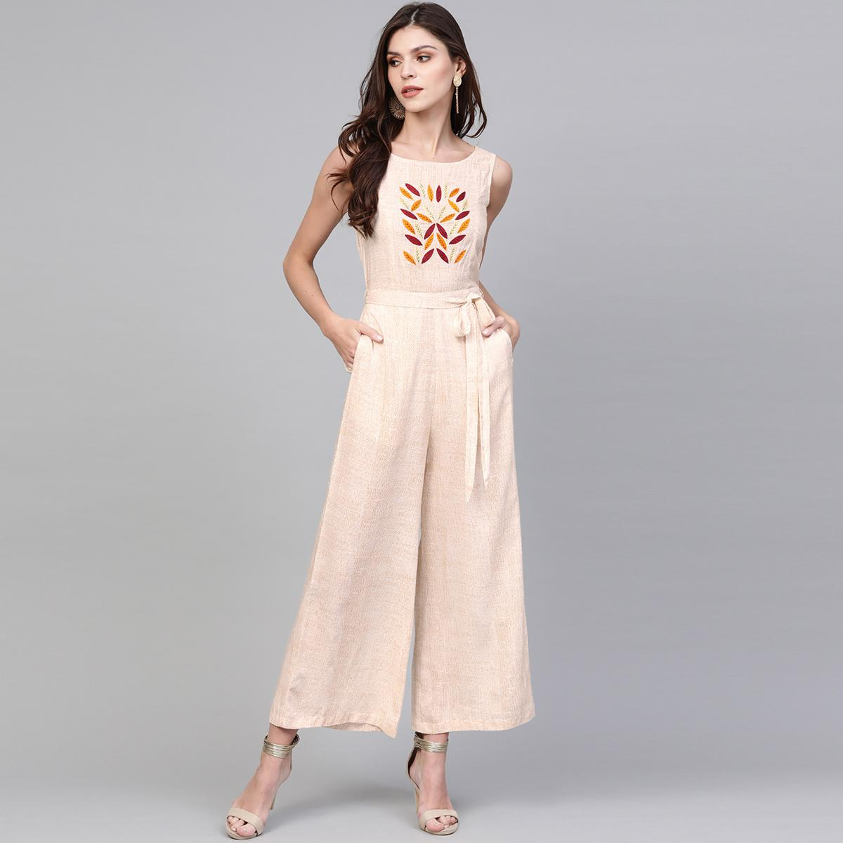 Lovely Beige Colored Casual Wear Embroidered Rayon Jumpsuit