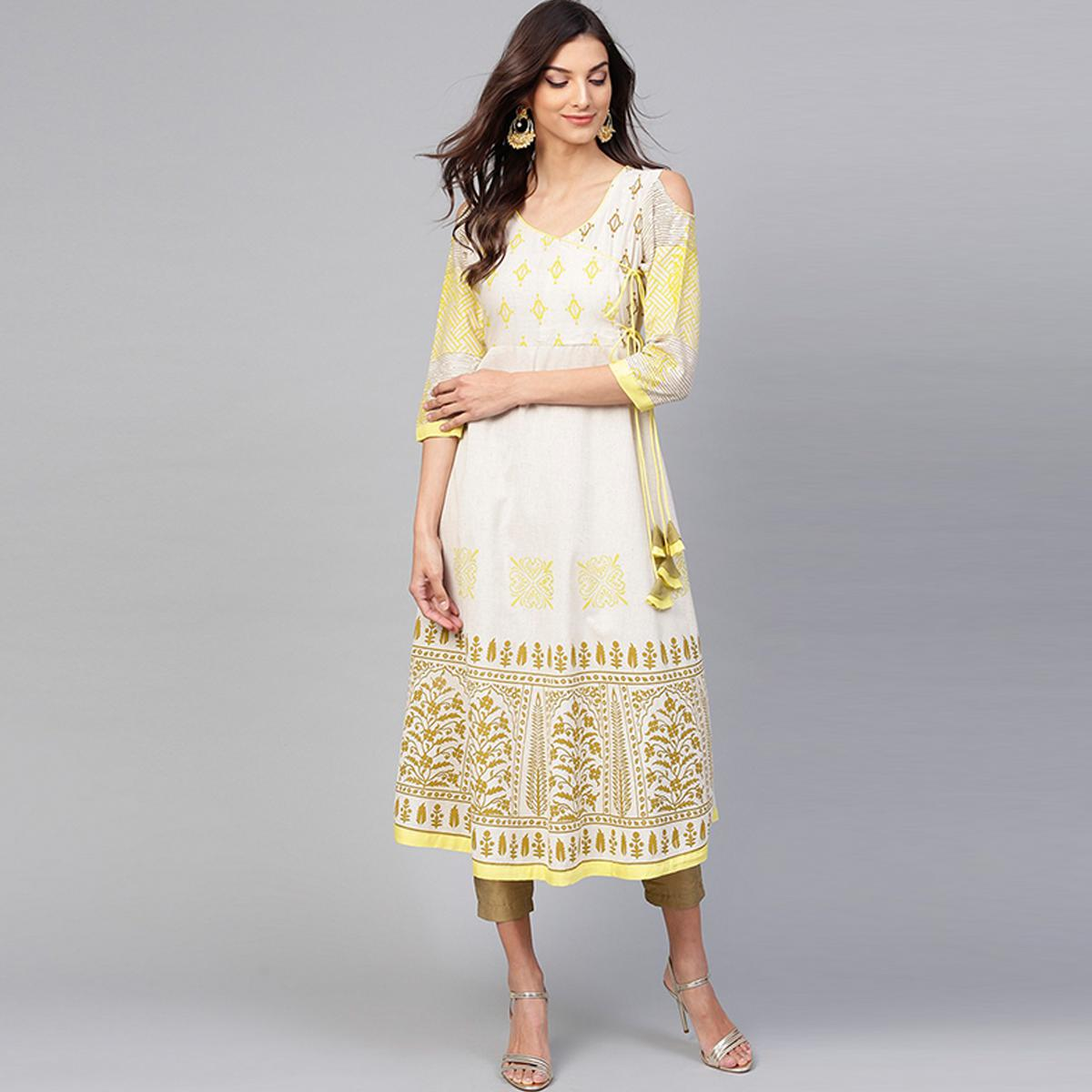 Capricious Off White Colored Casual Wear Cold Shoulder Printed Cotton Kurti