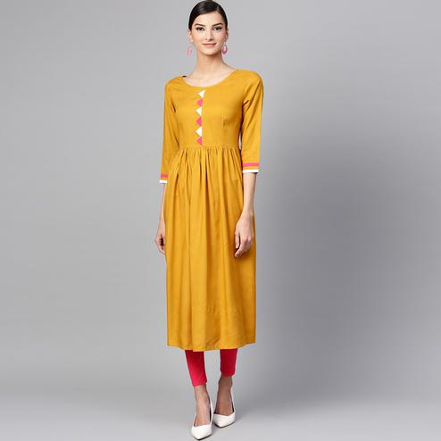 Flattering Mustard Yellow Colored Casual Wear Cotton Kurti With Floral Printed Shrug