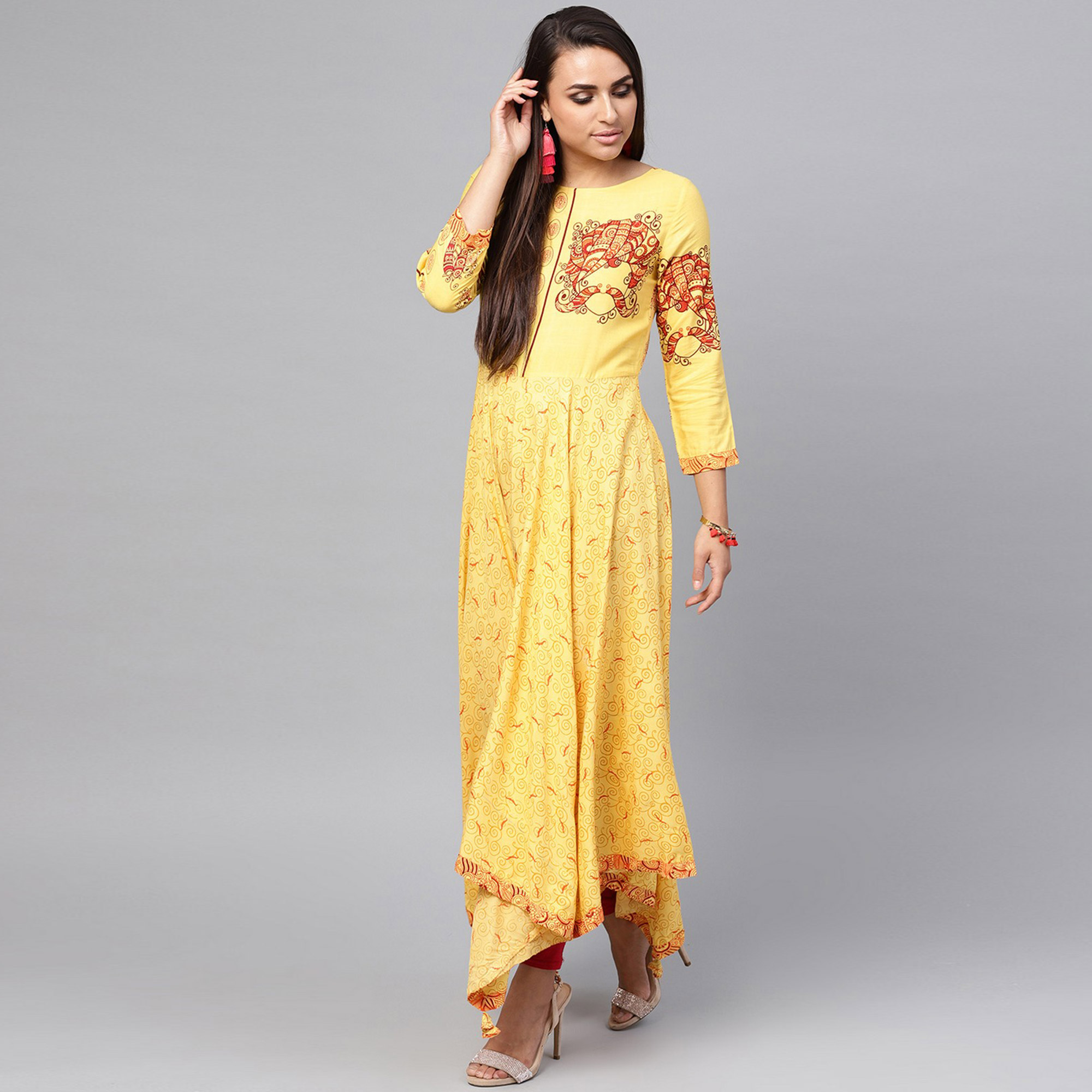 Adorable Yellow Colored Party Wear Printed Rayon Kurti