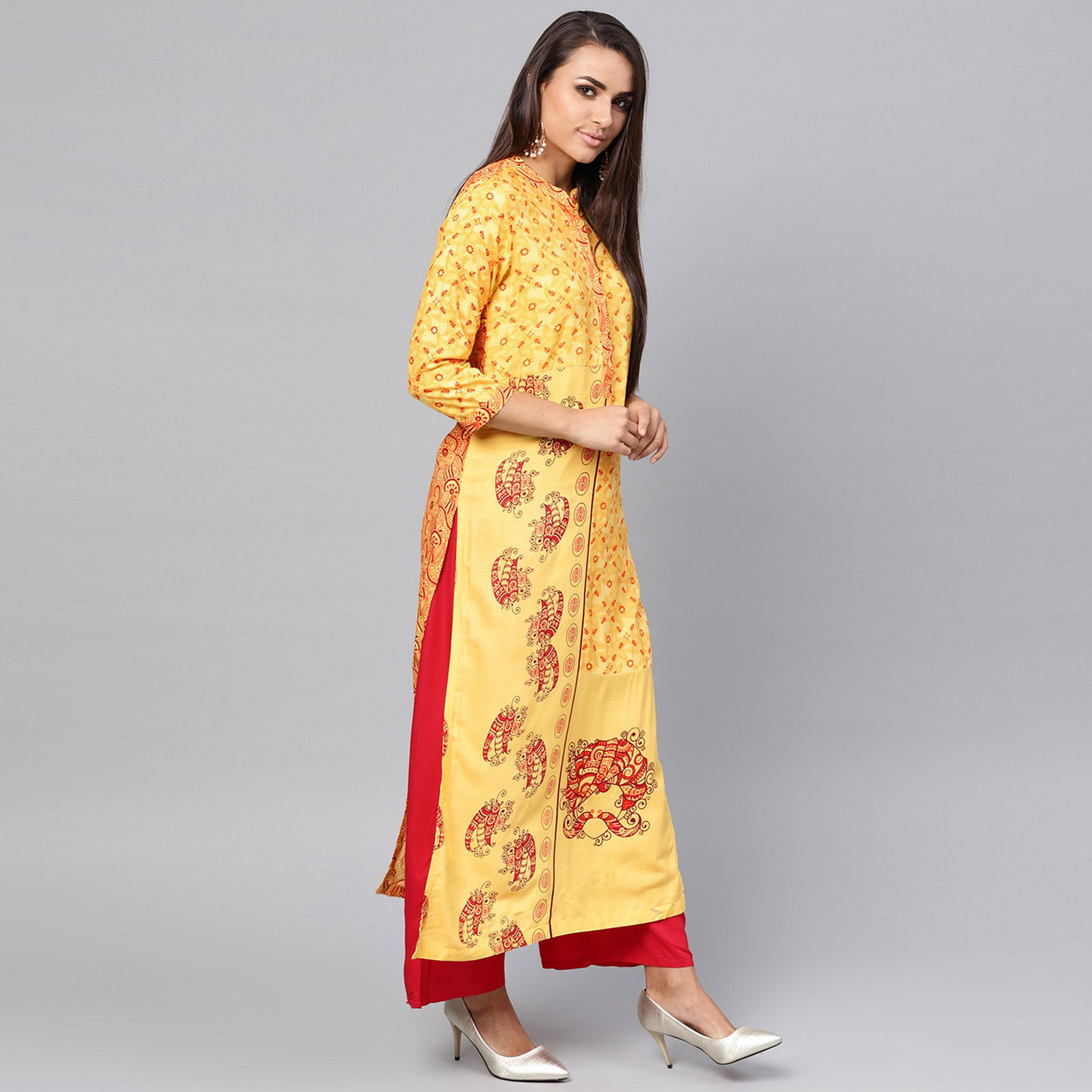Beautiful Yellow Colored Casual Wear Printed Rayon Kurti