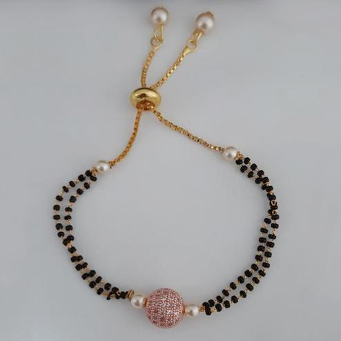 Eye-catching Gold Plated American Diamond Alloy Hand Mangalsutra