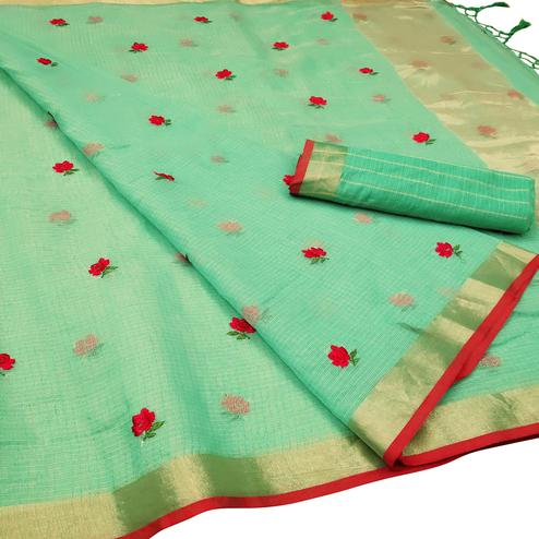 Arresting Turquoise Green Colored Party Wear Floral Embroidered Silk Saree With Tassels