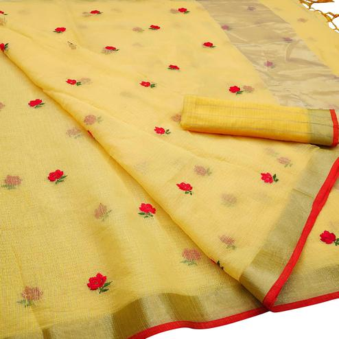 Exotic Yellow Colored Party Wear Floral Embroidered Silk Saree With Tassels