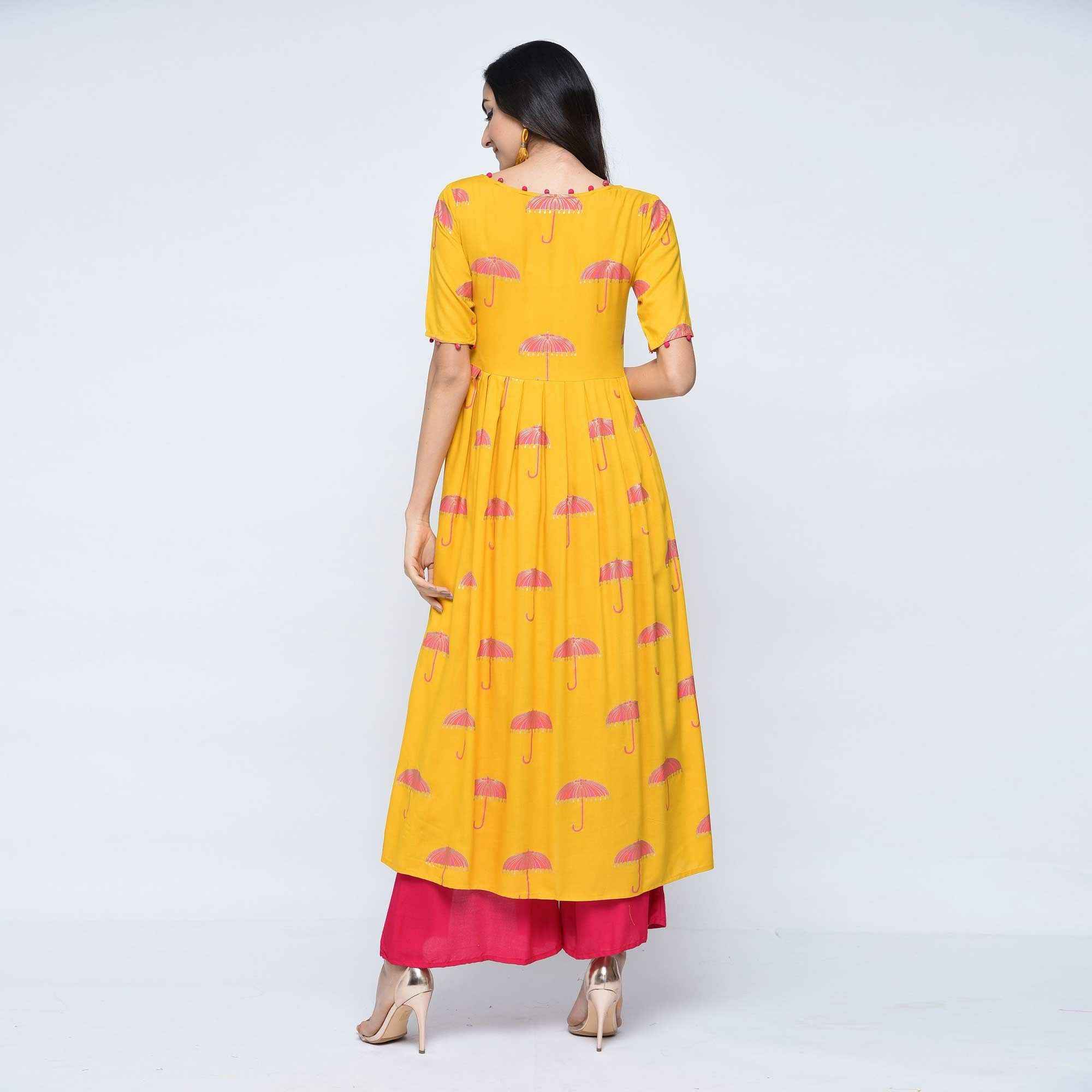 Ideal Yellow Colored Party Wear Foil Printed Rayon Kurti-Palazzo Set