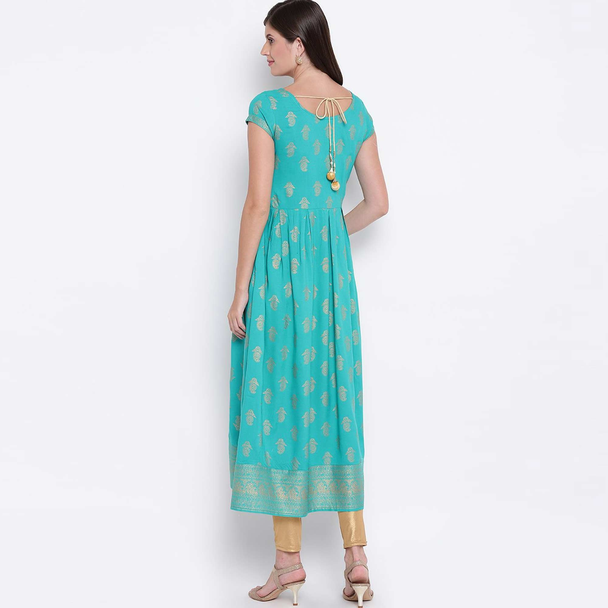 Mesmeric Turquoise Blue Colored Party Wear Foil Printed Rayon Kurti