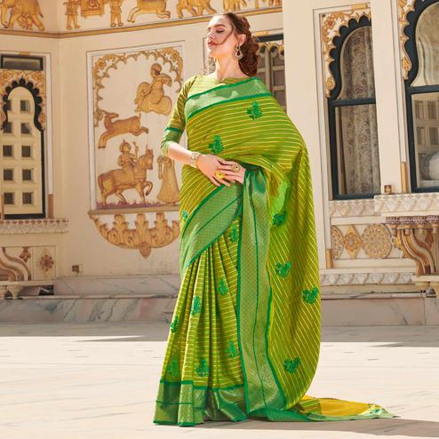 Opulent Green Colored Party Wear Embroidered Linen Silk Saree