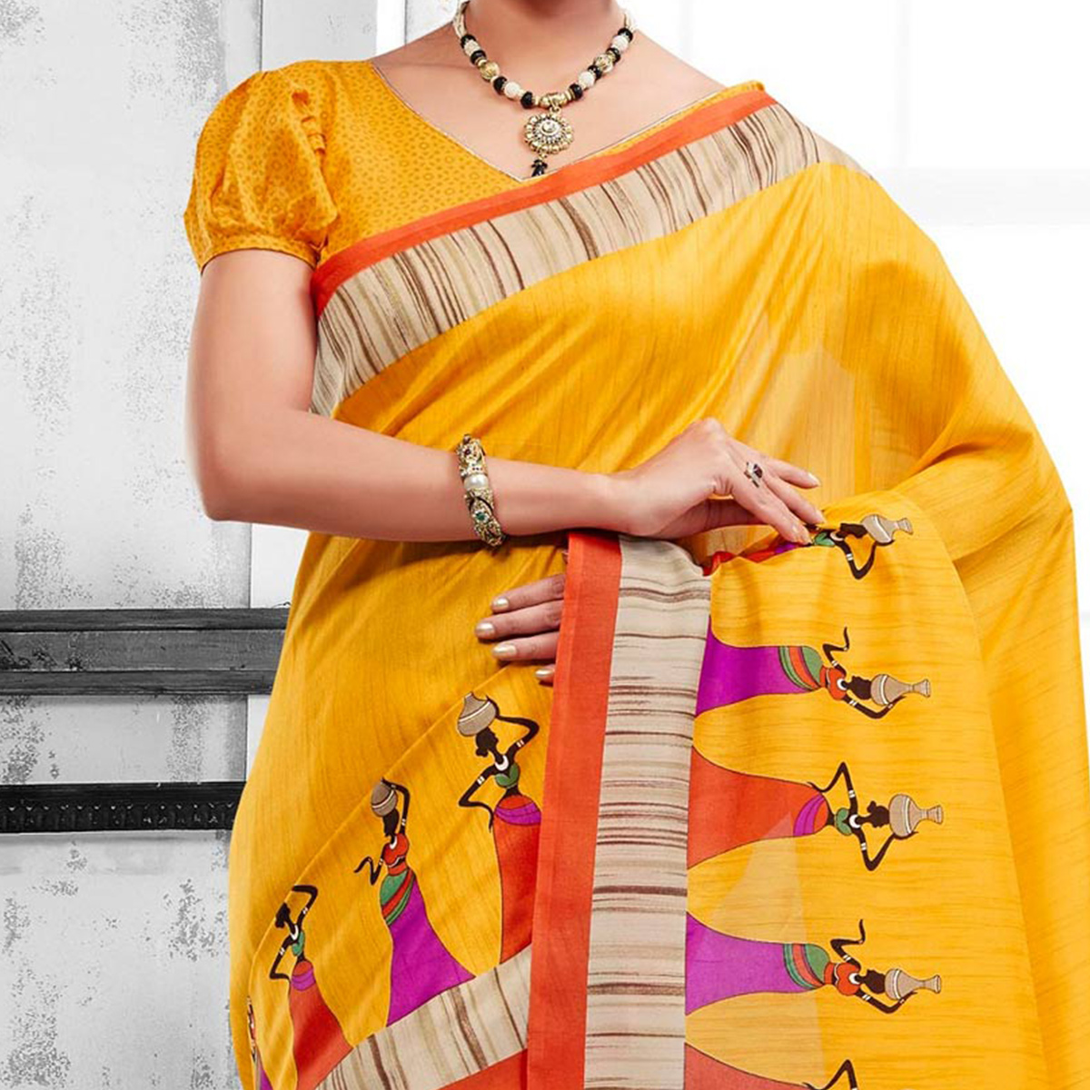 Yellow Traditional Folk Print Border Saree