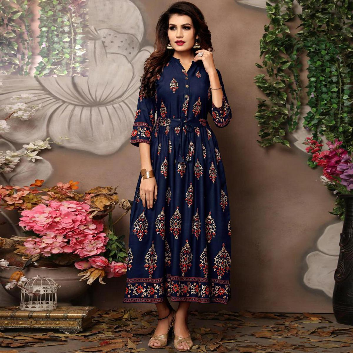 Glowing Navy Blue Colored Party Wear Foil Block Printed Rayon Kurti