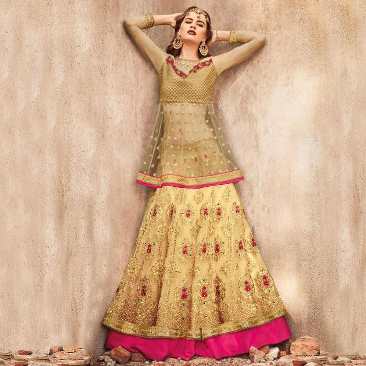 Glowing Golden-Pink Colored Party Wear Embroidered Net Lehenga Choli