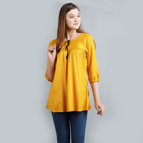 Alluring Mustard Yellow Colored Casual Wear Solid Rayon Top