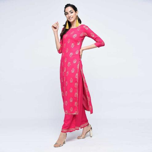Glorious Pink Colored Casual Wear Printed Straight Calf Length Rayon Kurti