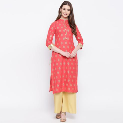 Graceful Peach Colored Casual Wear Printed Straight Calf Length Cambric Kurti