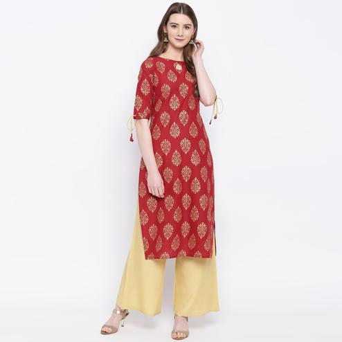 Charming Maroon Colored Casual Wear Printed Straight Calf Length Cambric Kurti