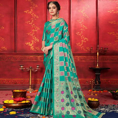 Captivating Turquoise Blue Colored Festive Wear Woven Work Banarasi Silk Saree