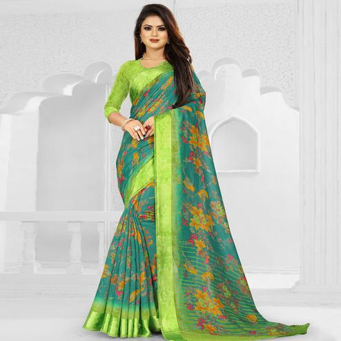 Preferable Sea Blue Colored Casual Wear Floral Printed Linen Saree With Satin Patta Border