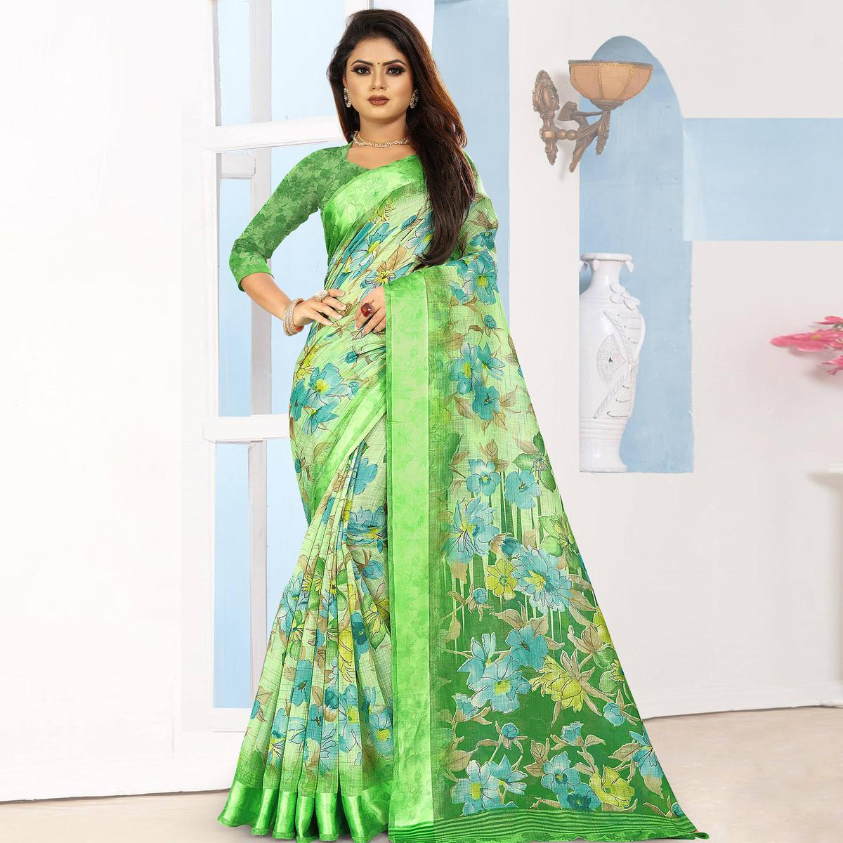 Flamboyant Green Colored Casual Wear Floral Printed Linen Saree With Satin Patta Border