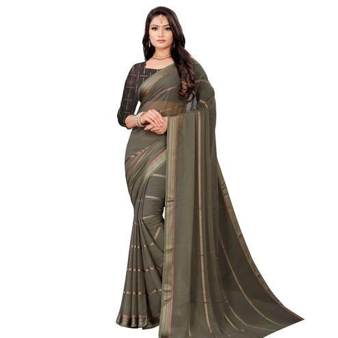 Glowing Grey Colored Casual Wear Georgette Saree