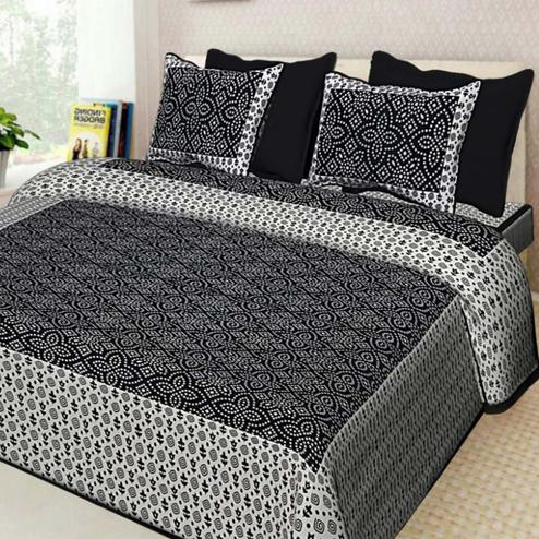 Glowing Black Colored Printed Cotton Double Bedsheet With 2 Pillow Cover