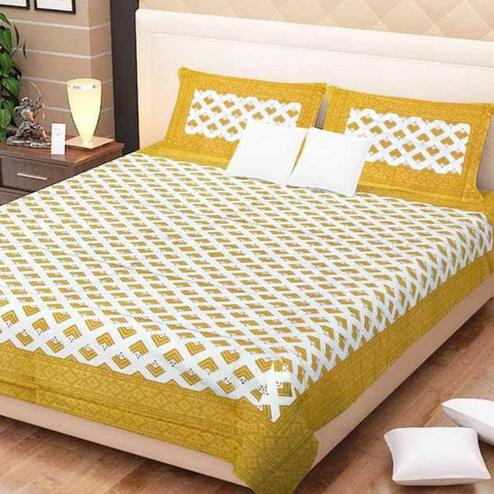 Adorning Yellow Colored Printed Cotton Double Bedsheet With 2 Pillow Cover