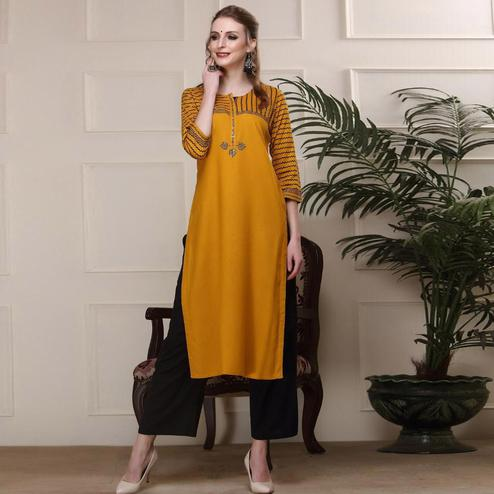 Intricate Mustard Yellow Colored Casual Wear Sequence Work Knee Length Handloom Cotton Kurti