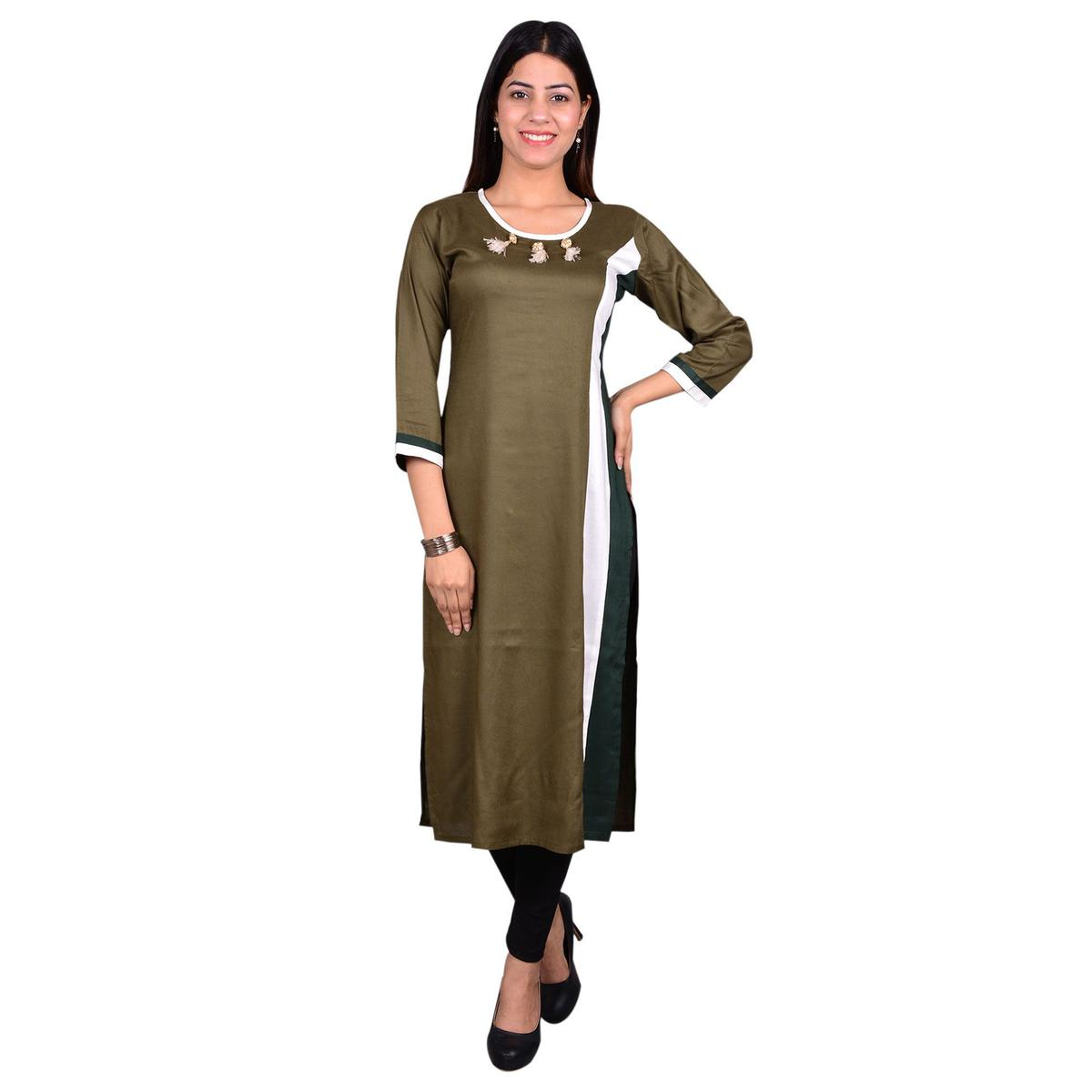 Engrossing Brown Colored Casual Wear Solid Viscose-Rayon Long Kurti