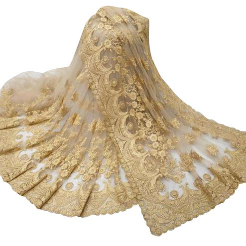 Mesmerising Cream Colored Party Wear Embroidered Net Saree