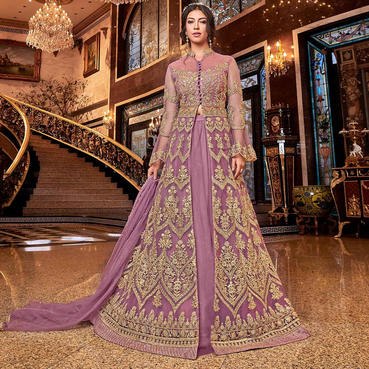 Intricate Purple Colored Partywear Embroidered Soft Net Anarkali Suit