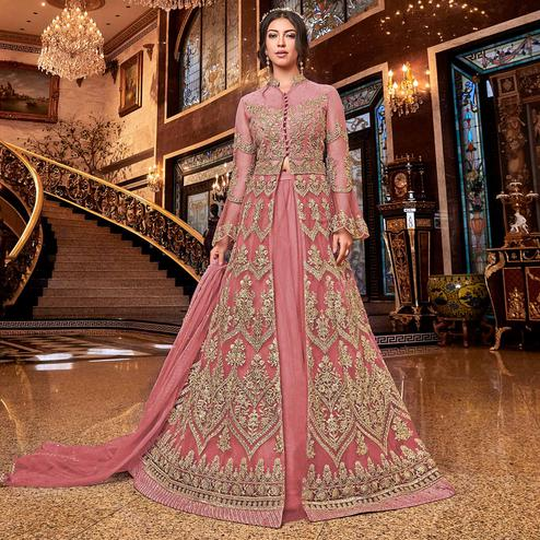 Sophisticated Peach Colored Partywear Embroidered Soft Net Anarkali Suit