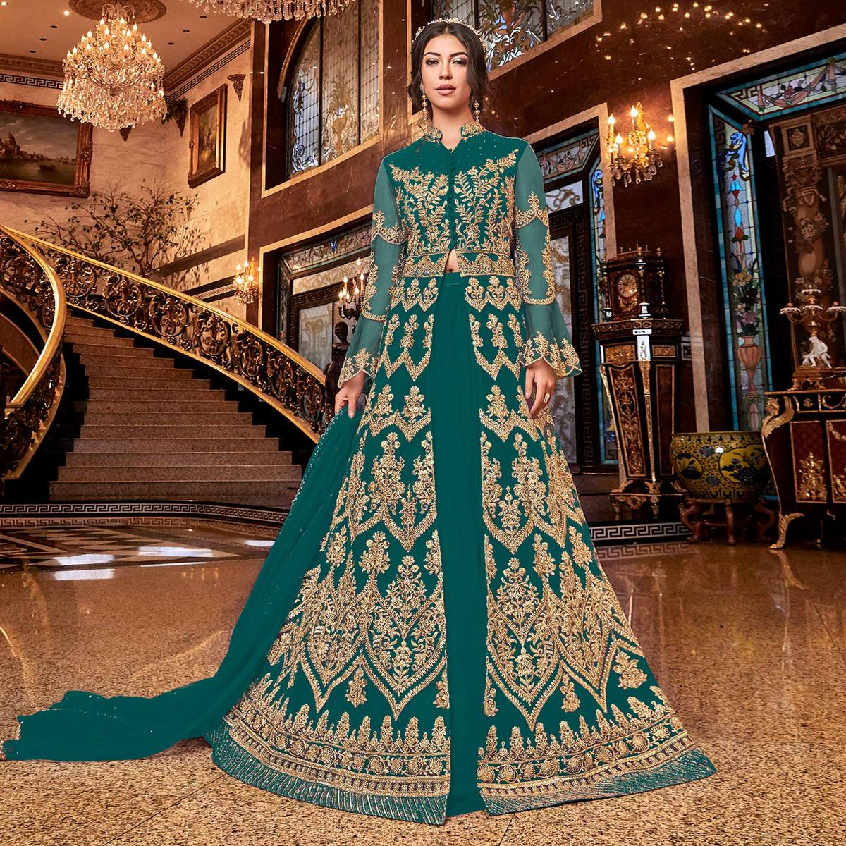 Elegant Rama Green Colored Partywear Embroidered Soft Net Anarkali Suit