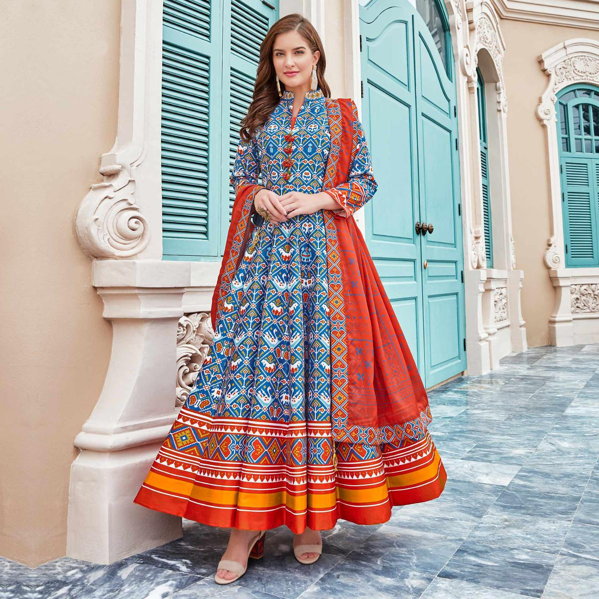 Radiant Sky Blue Colored Partywear Patola Printed Silk Anarkali Suit