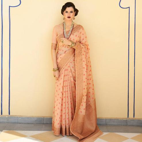 Beautiful Peach Colored Festive Wear Woven Linen Saree