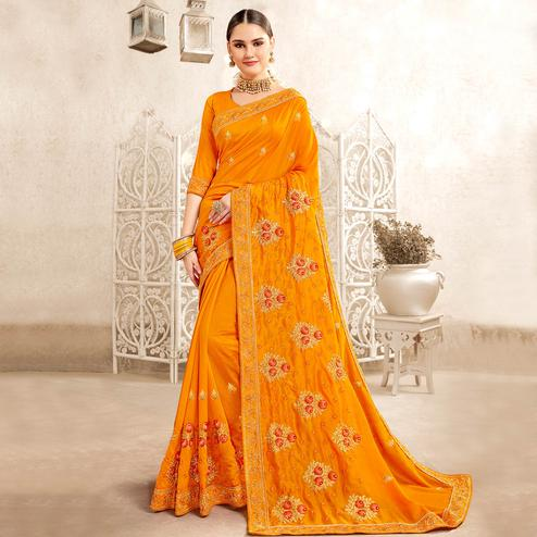 Gleaming Orange Colored Party Wear Embroidered Georgette-Art Silk Saree