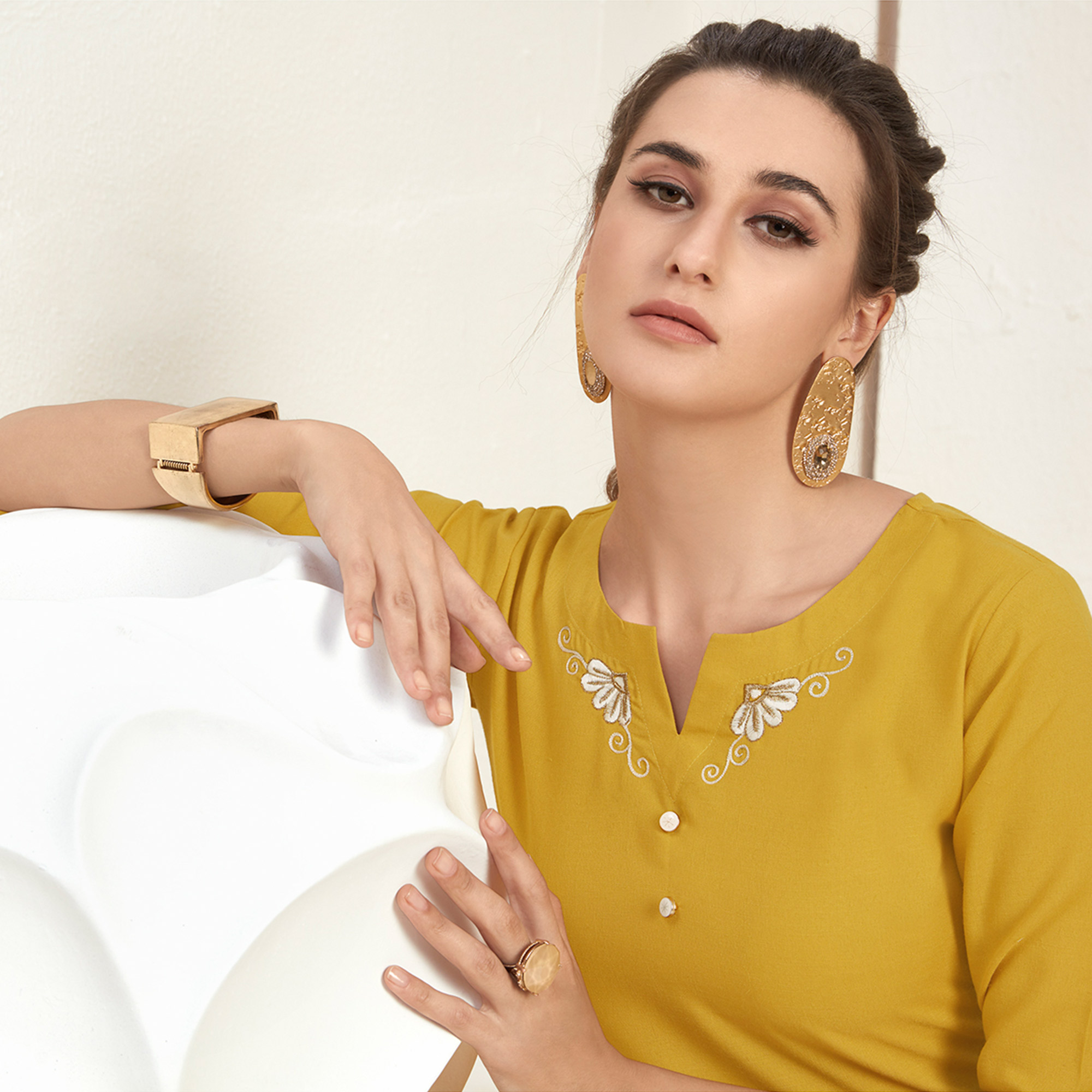 Innovative Yellow Colored Casual Wear Embroidered Cotton Kurti