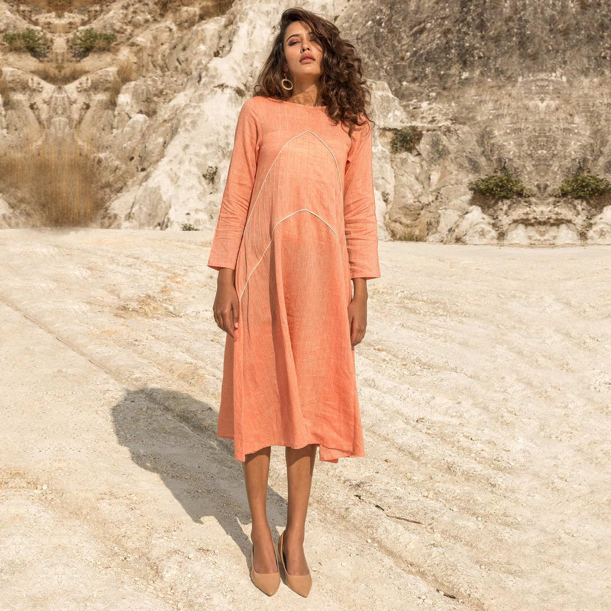 Alluring Peach Colored Diagonal Cut With Piping Hand-woven Cotton A- Line Tunic