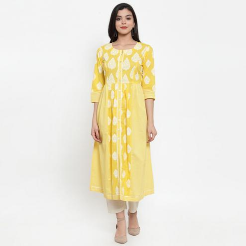 Attractive Yellow Colored Casual Wear Printed Calf Length A-Line Cotton Kurti