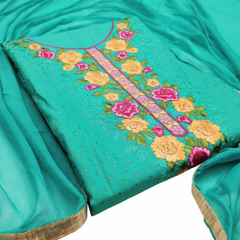 Prominent Turquoise Colored Partywear Embroidered Floral Cotton Dress Material