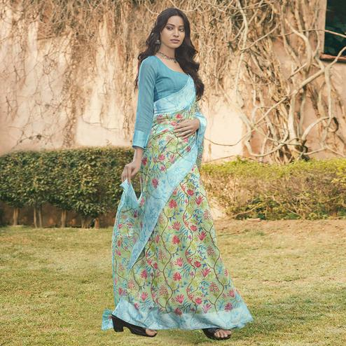Engrossing Sky Blue Colored Partywear Floral Printed Linen Cotton Saree