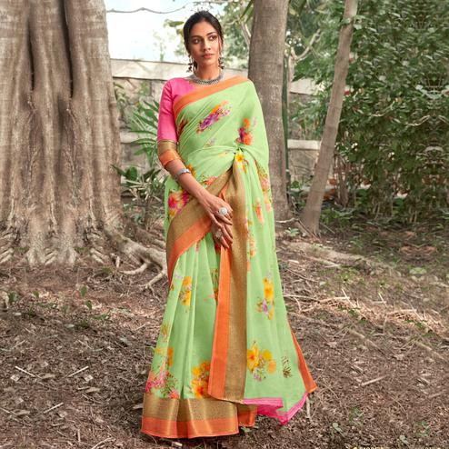 Intricate Pista Green Colored Partywear Floral Printed Linen Silk Saree