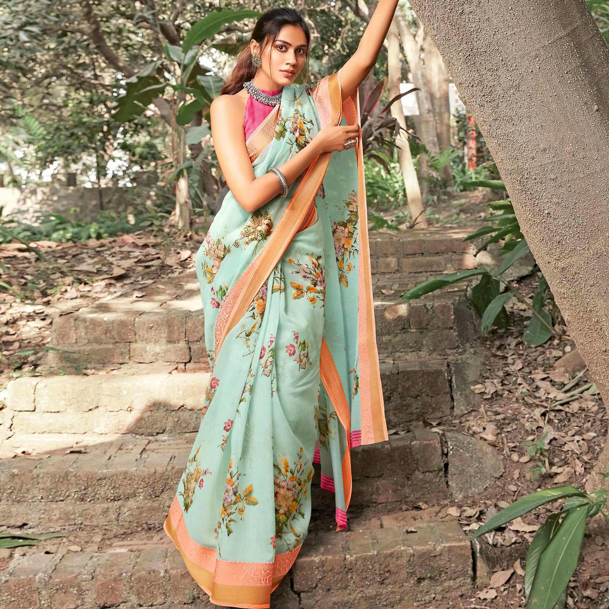 Sophisticated Light Blue Colored Partywear Floral Printed Linen Silk Saree