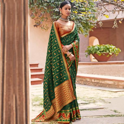 Flaunt Dark Green Colored Festive Wear Woven Silk Saree