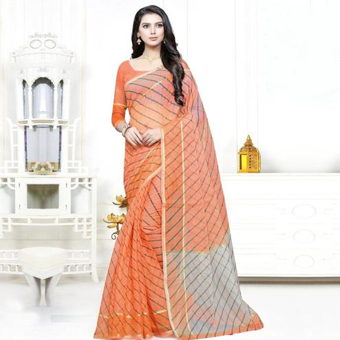 Unique Orange Colored Casual Wear Stripe Printed Kota Doria Cotton Saree With Tassels