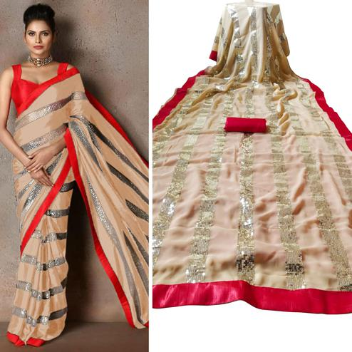 Adorning Cream Colored Party Wear sequence Work Georgette Saree