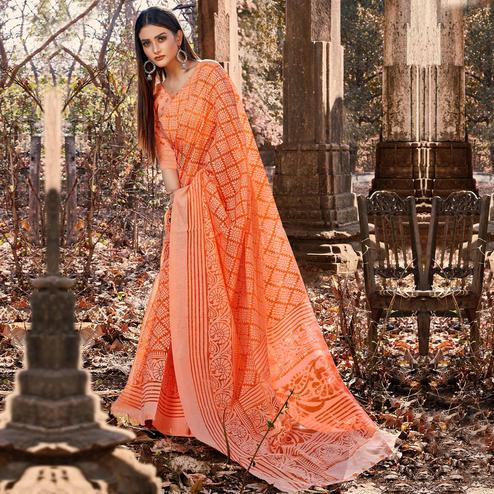 Desirable Orange Colored Casual Wear Floral Printed Brasso Saree