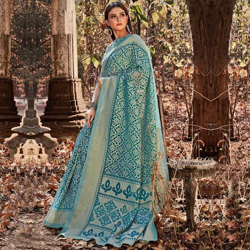 Radiant Teal Blue Colored Casual Wear Floral Printed Brasso Saree