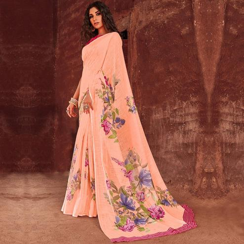 Entrancing Peach Colored Casual Wear Floral Printed Linen Saree