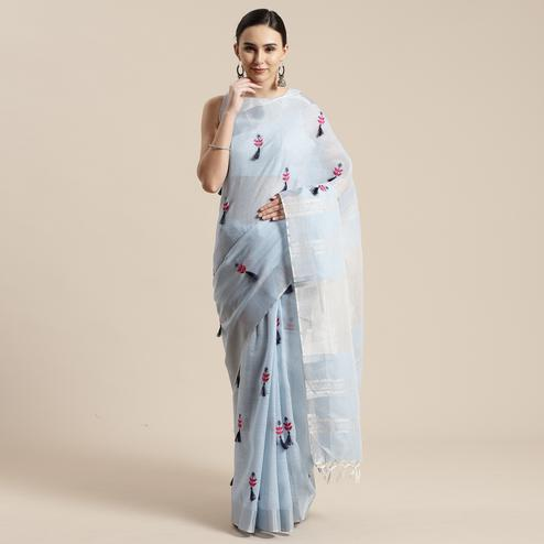 Dazzling Sky Blue Colored Festive Wear Floral Embroidered Linen Blend Saree With Tassels