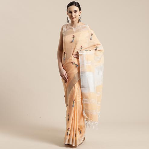 Surpassing Orange Colored Festive Wear Floral Embroidered Linen Blend Saree With Tassels